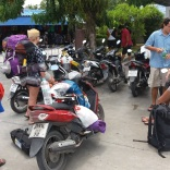 A petrol station pitstop with our overloaded bikes.
