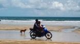 Local man and his son ride across Ao Yai